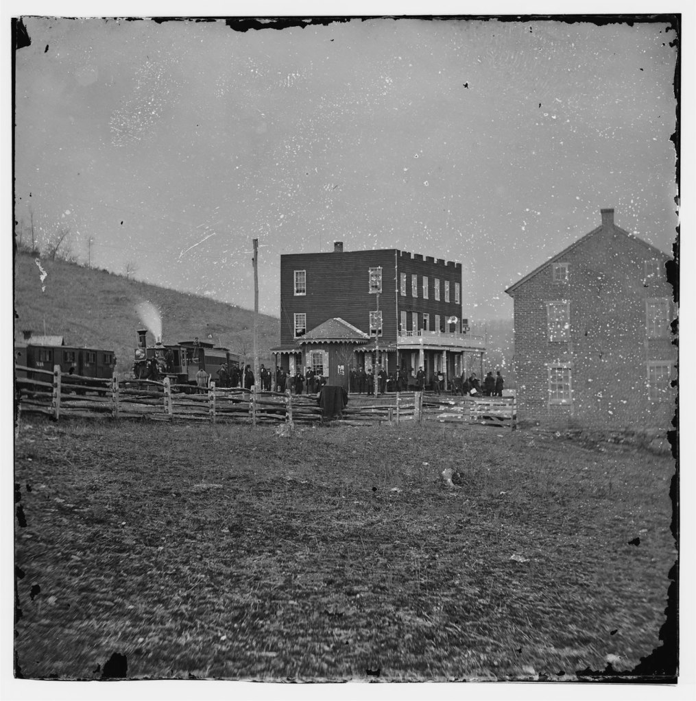 Hanover Junction, Pennsylvania. Passenger train and crowd at station, 1863