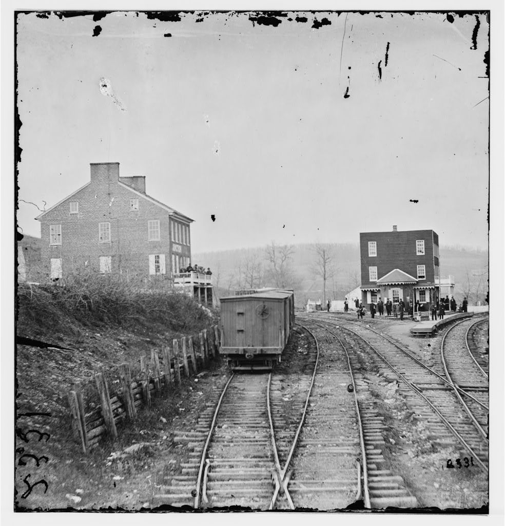 Hanover Junction, PA. View of railroad station and boscars.