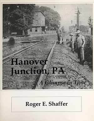 Cover of Hanover Junction, PA: A Glimpse in Time by Roger E. Shaffer. Image shows track workers standing next to the tracks with the Hanover Junction station in the background.