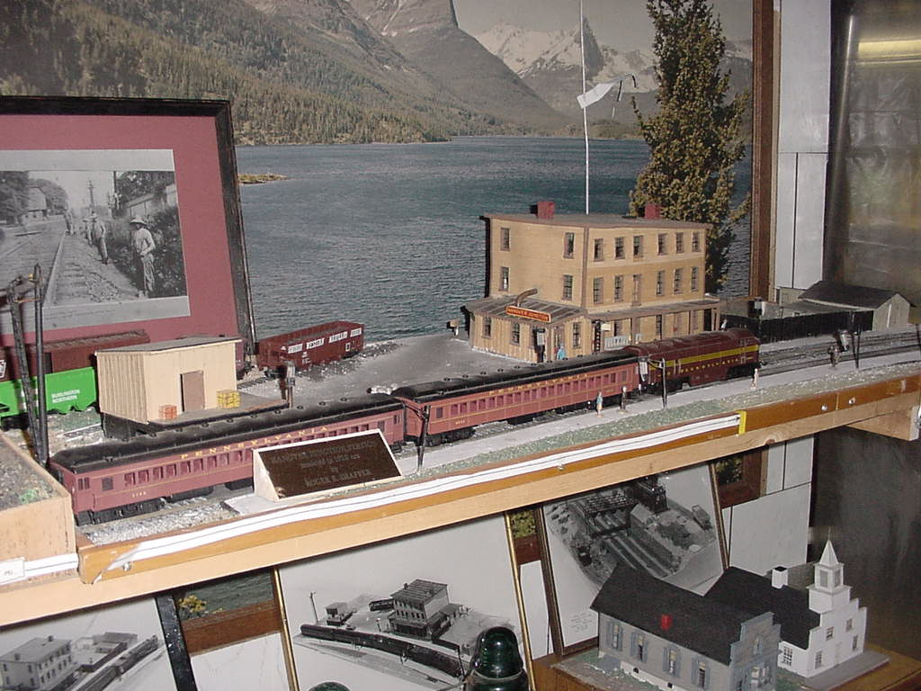 Overall view of Hanover Junction Railroad Station model showing passenger cars on the main PRR line. Also shows coal car on Western Maryland track to Hanover going behind station house.