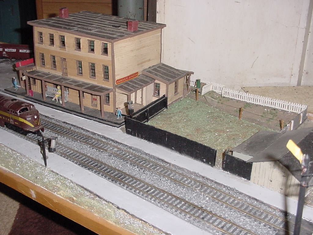 Model of Hanover Junction Railroad Station, northern corner of building. Double tracks pass in front of the building.