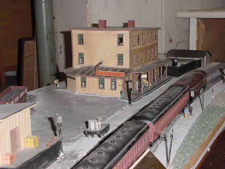 Hanover Junction Railroad Station model showing milk cans on the platform, ready to be picked up.